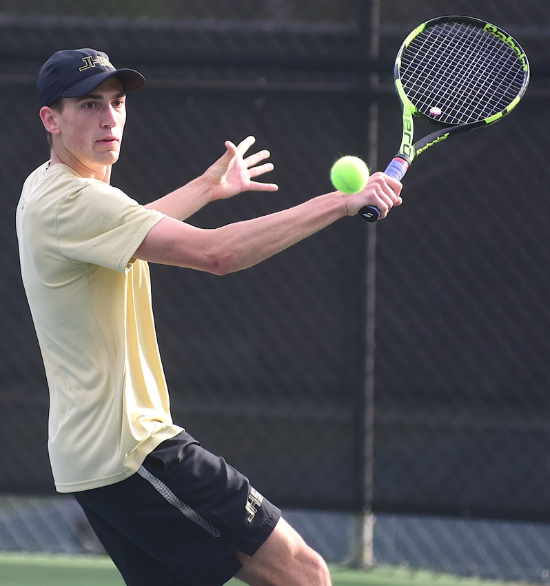 Jasper's Stephen Williams hits a backhand during his No. 5 singles match against Indian Springs at Valley Park on Tuesday. Jasper won the boys match 9-0 and the girls picked up an 8-1 win.