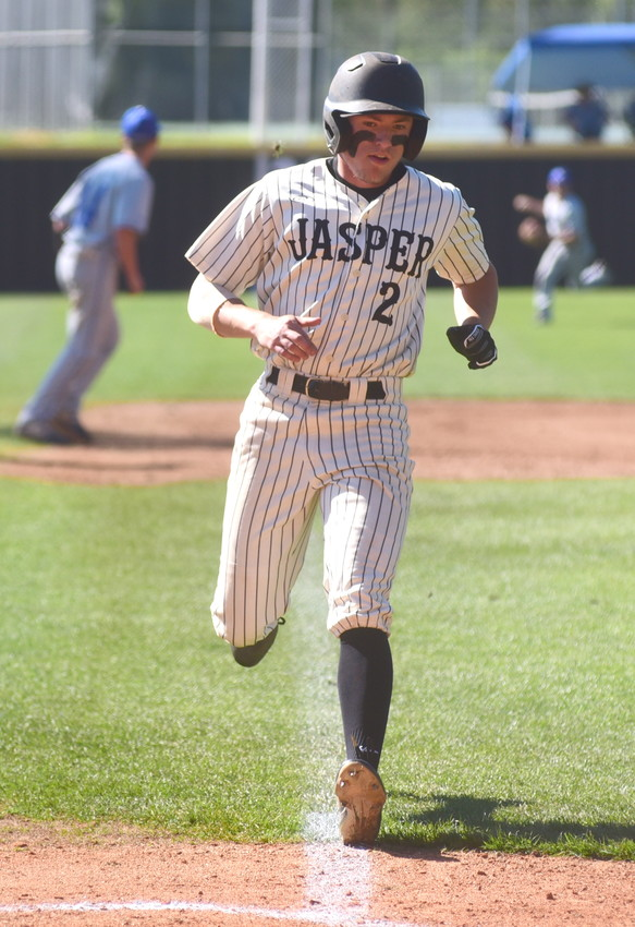 Jasper's Landon Nix scores a run against Mortimer Jordan during their game at Valley Park on Wednesday. The Vikings clinched the Class 5A, Area 11 title with an 8-2 win over the Blue Devils at Valley Park.