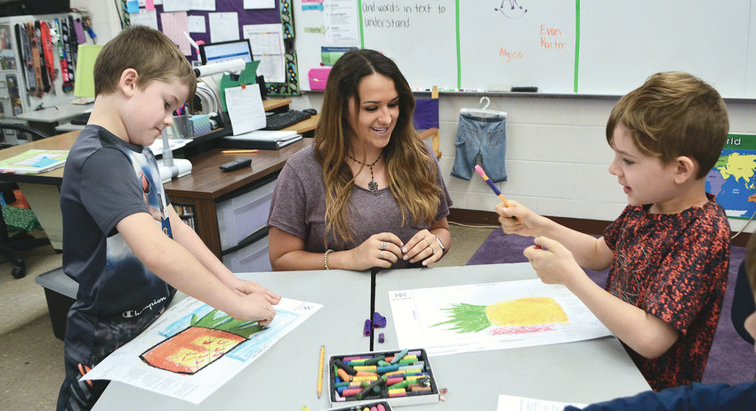 Artist Sarah O'Mary Roberts, center, helps Lupton Jr. High students learn to use oil pastels on Friday. Student art will be on display at an upcoming event at the school.