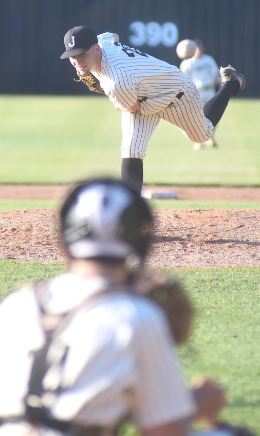 Jasper's Seth Davidson fires a pitch against Etowah during their game Monday at Valley Park. The Blue Devils held Jasper to one hit in a 6-0 victory in game 3 of their best-of-three, first-round series.
