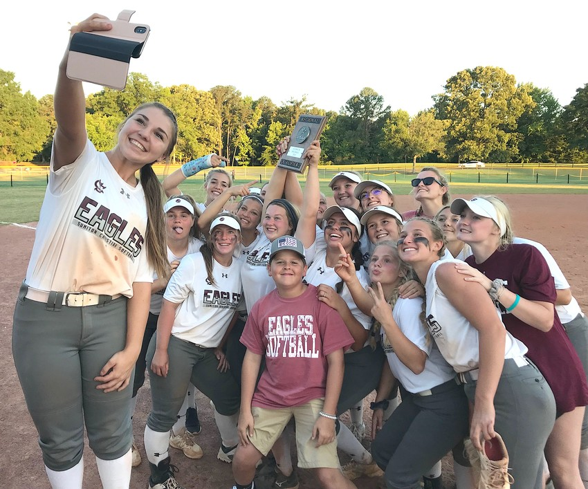 Sumiton Christian's AK Tyree, left, takes a group shot of the team following the Eagles' 13-3, six-inning victory over Sulligent at Bowers Park in Tuscaloosa on Monday. Sumiton Christian won three elimination games to earn their 11th straight trip to the State Softball Tournament in Montgomery.