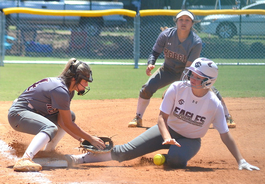 Sumiton Christian's Kaley McCrary slides safely into third base during the Eagles' win over Thorsby at the State Softball Tournament in Montgomery on Wednesday. Sumiton Christian went 1-2 on the day, falling to G.W. Long, beating Thorsby and losing to Sand Rock.