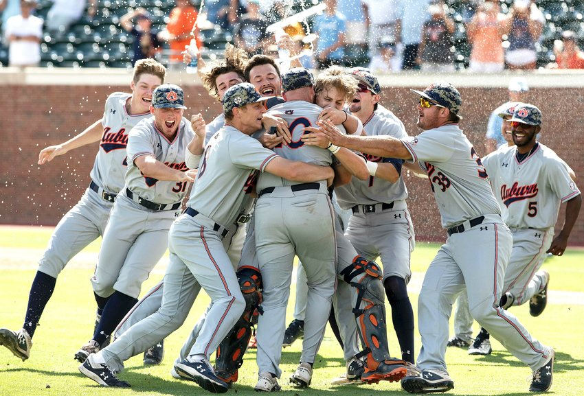 Auburn players celebrate their victory over North Carolina in an NCAA college super regional baseball game in Chapel Hill, N.C., on  Monday. The Tigers scored 13 runs in the first inning, earning a 14-7 win over the Tar Heels.