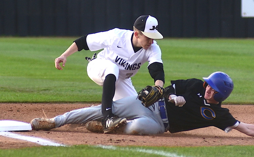 Jasper's Tyler Thomasson tags a Curry player at third base during their game this season. Thomasson is the Eagle Elite Pitcher of the Year after going 7-0 on the mound.