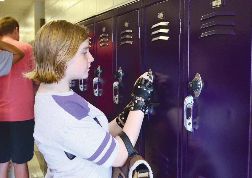 Rising seventh-grader Ashley Brannan practices opening her locker at Parrish Elementary/Jr. High School on Tuesday.