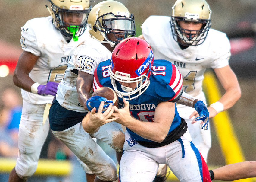 Dora defenders track down Cordova's Jack Gable (16) during their game last week. Dora defeated the Blue Devils 27-15. Dora hosts Carbon Hill in the DME PrepZone Game of the Week today. The game kicks off at 7 p.m. at Horace Roberts Field.