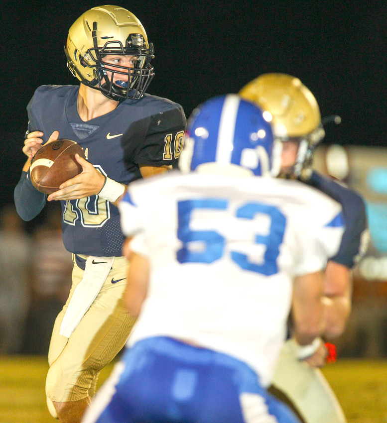 Dora quarterback Matthew Busby (10) looks for an open receiver during Friday night's game against Carbon Hill at Horace Roberts Field. Dora won the battle of Bulldogs 42-14.