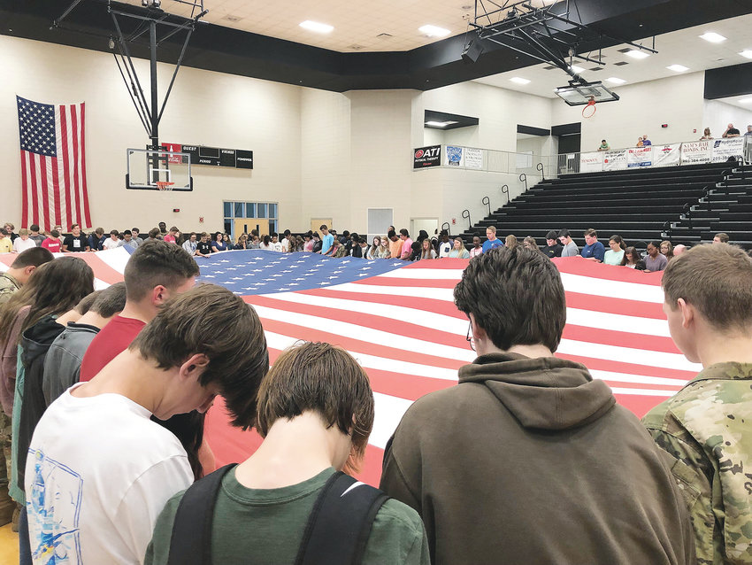 See You at the Pole was held at schools around the country on Wednesday for students to join in prayer before school. Jasper High School students, pictured, participated, as well as other county schools. Students either meet around a flag pole or an American flag to pray for their schools, families, and country.