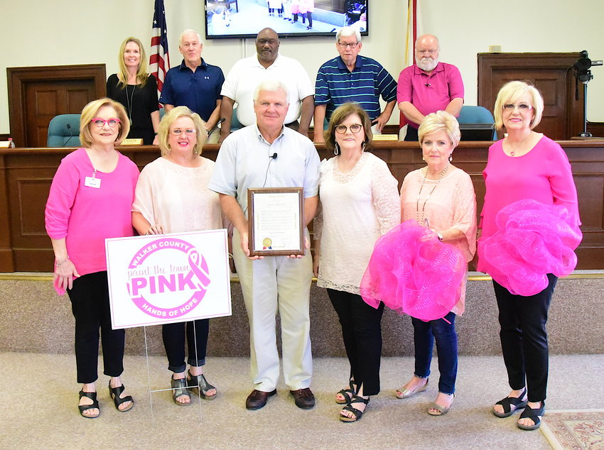 Jasper Mayor David O'Mary presents a proclamation recognizing October as 'Paint the Town Pink' Month in the city in observance of National Breast Cancer Awareness Month.