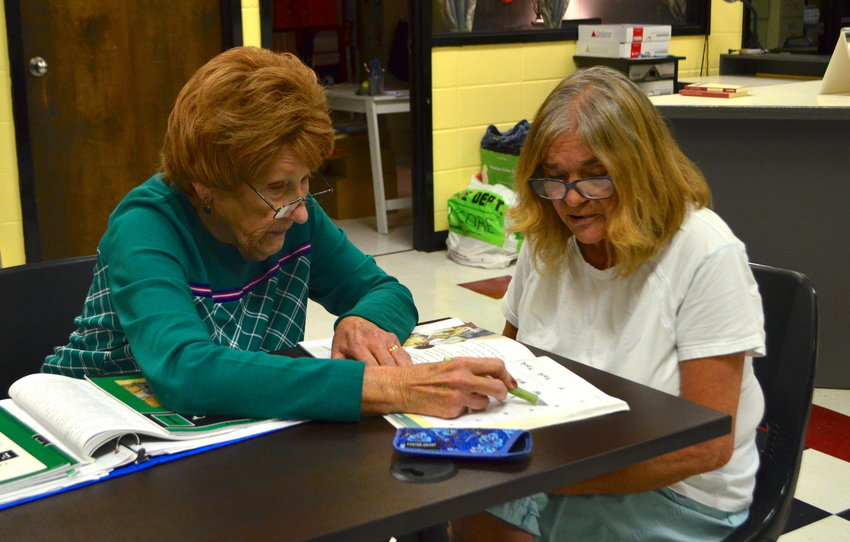 Sharon Burton, at right, learns reading skills from retired teacher Pat Spears, at left, at The Literacy Council of Walker County office.