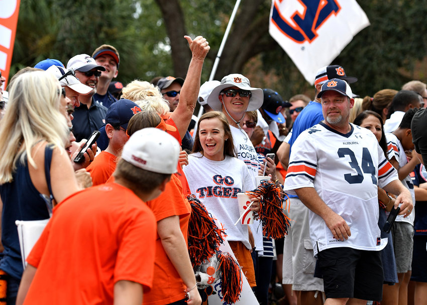 Auburn fans await the arrival of the team for the Tiger Walk prior to the Florida Gators versus Auburn Tigers NCAA football game Saturday, Oct. 5, 2019, at Ben Hill Griffin Stadium in Gainesville, Fla.