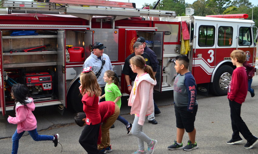 Members of the Jasper Fire Department visited Memorial Park Elementary School Friday morning to teach students fire safety. Firefighters also worked to develop a trusting relationship with the children, in the event that a firefighter has to rescue them one day. Memorial Park Principal Eric Rigsby said firefighters visit the school each year, and their teachings helped once save a student's life when they had to escape a house fire.