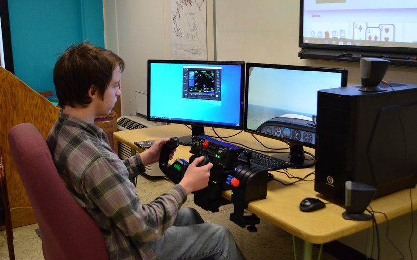 Carbon Hill High School sophomore Jonathon Vinson uses a flight simulator at the Walker County Center of Technology.