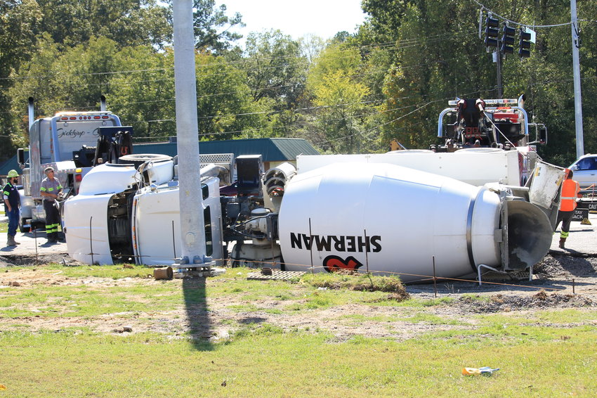 Westbound lanes of Highway 78 in Jasper were shut down on Tuesday afternoon after a concrete truck overturned near Airport Road.  Two wreckers were dispatched to get it upright. No injuries were reported.