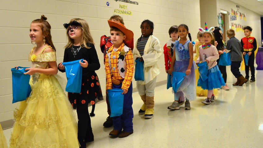 Sumiton Elementary School let students trick or treat at the school early Thursday morning to celebrate Halloween. Children had the opportunity to wear their favorite costumes and receive candy from staff members.
