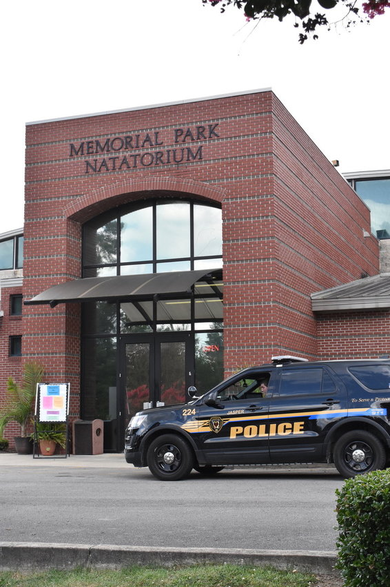 A police car sits outside the Memorial Park Natatorium on July 6 after the drowning of 5-year-old Faithlynn Blankenship.