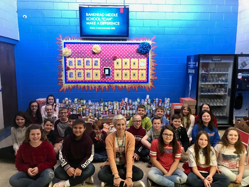 Bankhead Middle School recently held a successful canned food drive. The school's goal was to collect 1,000 cans, but 2,852 were donated. Mrs. Pate's homeroom collected 1,000 cans and won a pizza party. The second place for donations went to Mrs. Chatham's class for collecting 491 cans, and Mrs. Scarberry's class brought 408 cans, earning third place. Bankhead Principal Amber Freeman said the cans were donated to Cordova's food bank at Long Memorial Methodist Church.
