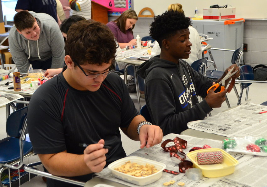 Oakman High School students craft ornaments last Friday as part of serve day activities.