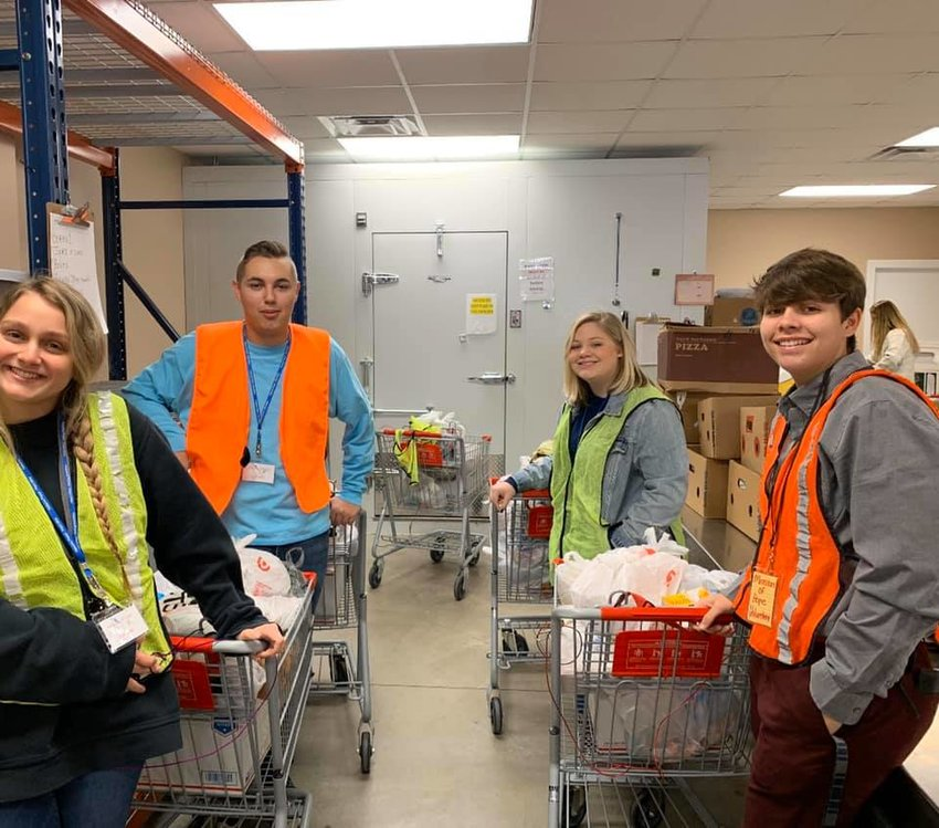 Dora High School Beta Club students volunteered at Mission of Hope in Dora in early December. Students sorted through food that will be distributed to members of the community this holiday season.