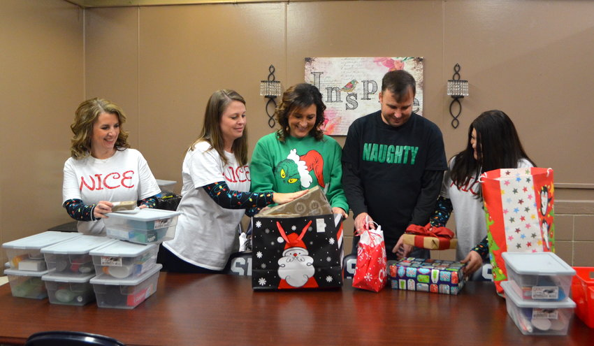 Sumiton Middle School faculty/staff members work to organize items that will go to students in need this Christmas.