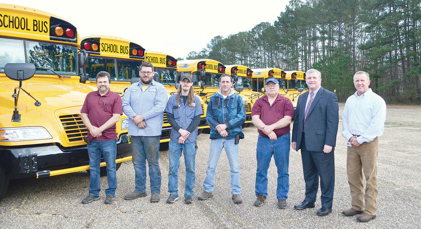 Members of the Walker County Board of Education's transportation department and central office stand in front of new school buses that arrived on Thursday.