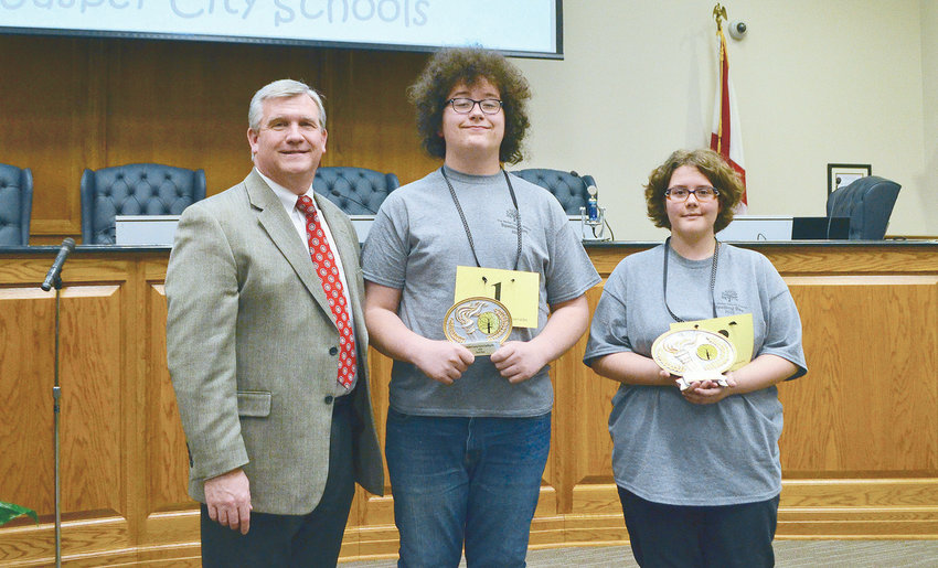 From left to right, Walker County Schools Superintendent Dr. Joel Hagood is pictured with spelling bee runner-up Lance Bonikowski and winner Annaleigh Tubbs.