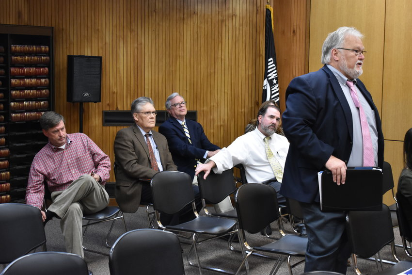 Walker County Probate Judge Lee Tucker speaks to the Walker County Commission Monday. Listening from behind are, from left, Judges Chris Sherer, Hoyt Elliot, Doug Farris, and Henry Allred. Behind Allred is Circuit Clerk Susan Odom.