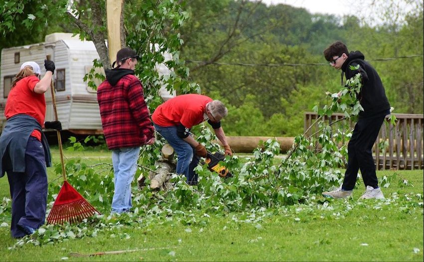 Lots of people were out Monday helping those who had been affected the most by an EF-1 tornado that swept through Carbon Hill Sunday night.