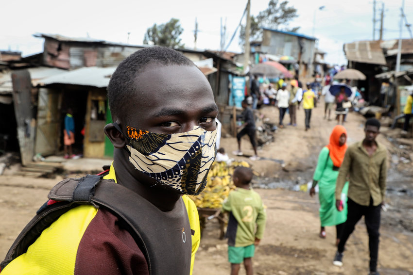 *** HOLD FOR ALYSSA ***.FILE - In this Friday, March 20, 2020 file photo, a boda-boda, or motorcycle taxi, driver wears a makeshift mask made from a local fabric known as Kitenge as he looks for customers in the Kibera neighbourhood of Nairobi, Kenya. As Africa braces to become the next coronavirus hotspot, its countries are far behind in the global race for medical equipment and outbid or outmaneuvered by richer nations, jolting African officials to scramble for solutions and join forces, creating a pooled purchasing platform under the African Union to improve their negotiating power. (AP Photo/Patrick Ngugi, File)