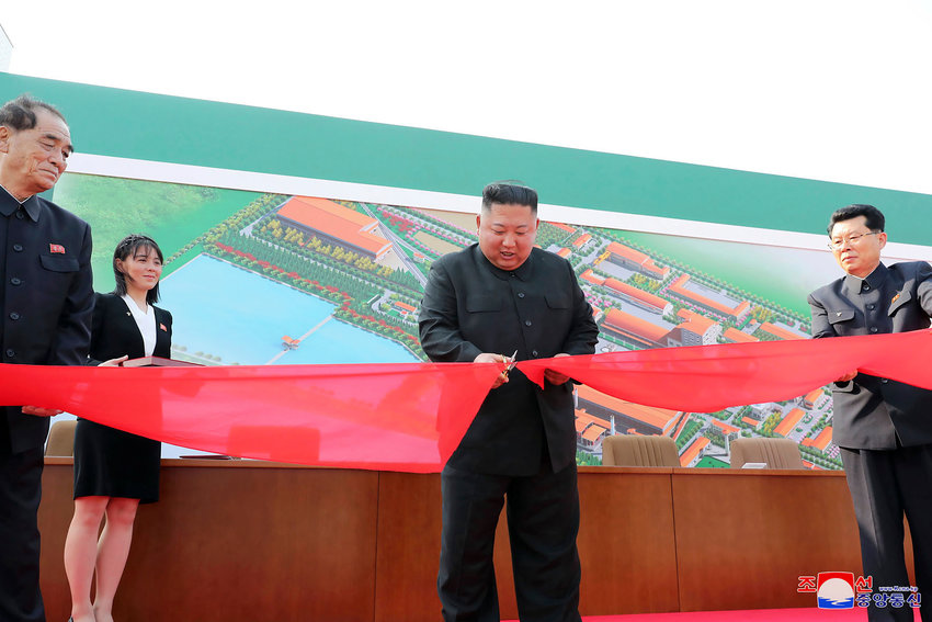 "In this Friday, May 1, 2020, photo provided by the North Korean government, North Korean leader Kim Jong Un, center, cuts a tape, watched by his sister Kim Yo Jong, during his visit to a fertilizer factory in Sunchon, South Pyongan province, near Pyongyang, North Korea. Kim made his first public appearance in 20 days as he celebrated the completion of the fertilizer factory, state media said Saturday, May 2, 2020, ending an absence that had triggered global rumors that he may be seriously ill. Independent journalists were not given access to cover the event depicted in this image distributed by the North Korean government. The content of this image is as provided and cannot be independently verified. Korean language watermark on image as provided by source reads: ""KCNA"" which is the abbreviation for Korean Central News Agency. (Korean Central News Agency/Korea News Service via AP)"