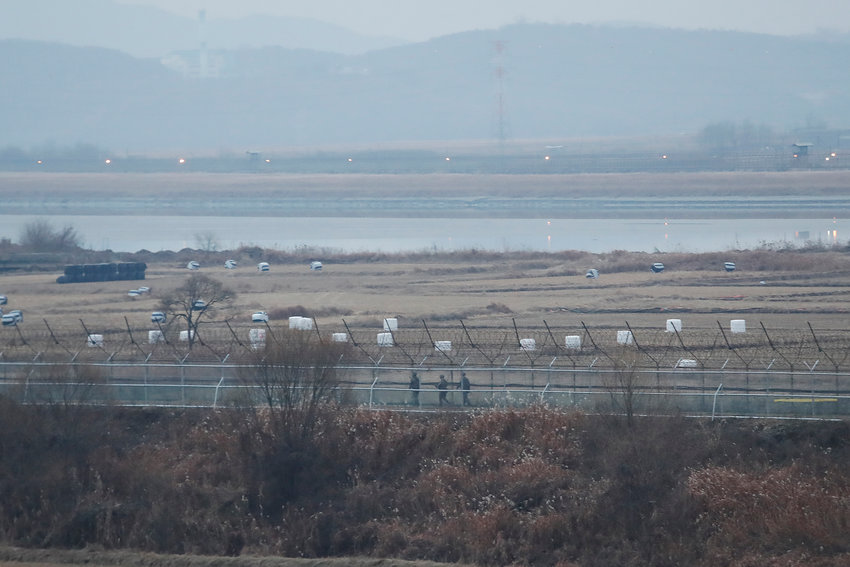 FILE - In this Dec. 16, 2019, file photo, South Korean army soldiers patrol along the barbed-wire fence in Paju, South Korea, near the border with North Korea. The Joint Chiefs of Staffs in Seoul said that North Korean troops fired several bullets at a South Korean guard post inside the heavily fortified border between the countries on Sunday, May 3, 2020. (AP Photo/Ahn Young-joon, File)