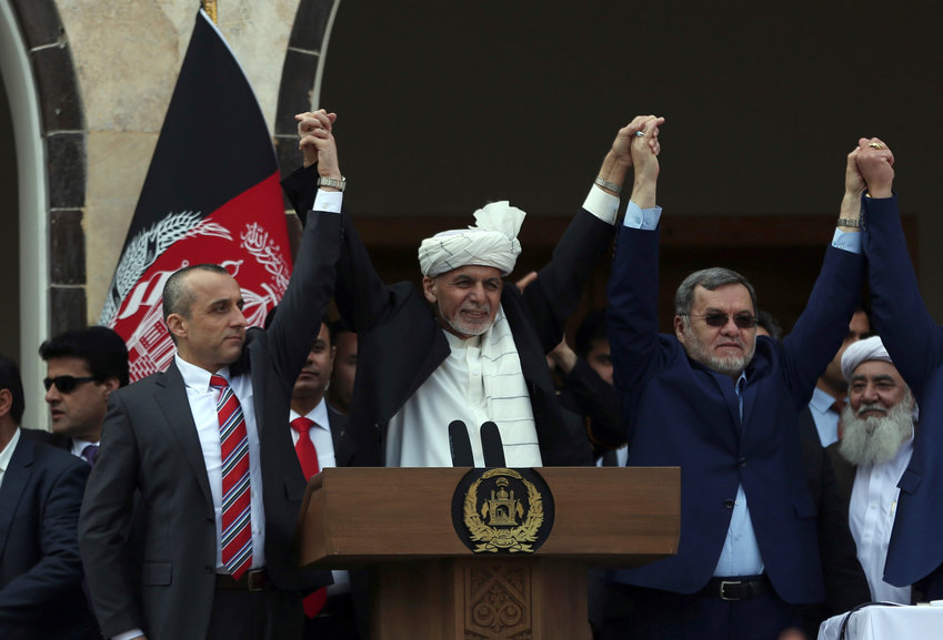 FILE- in this Monday, March 9, 2020, photo, Afghan President Ashraf Ghani, center, second Vice President Sarwar Danish, right, and first Vice President Amrullah Saleh, left, at an inauguration ceremony at the presidential palace in Kabul, Afghanistan. (AP Photo/Rahmat Gul, FILE)