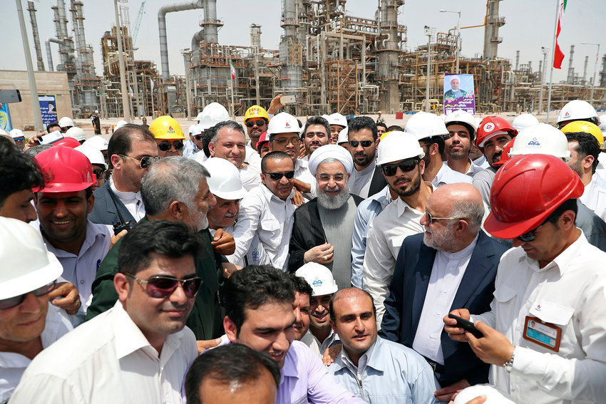 In this April 30, 2017 file photo released by an official website of the office of the Iranian Presidency, Iranian President Hassan Rouhani, center, inaugurates the Persian Gulf Star Refinery in Bandar Abbas, Iran. Five Iranian tankers likely carrying at least $45.5 million worth of gasoline and similar products are now sailing to Venezuela as of Sunday, May 17, 2020, part of a wider deal between the two U.S.-sanctioned nations amid heightened tensions between Tehran and Washington. Analysts say the gasoline they carry came from the Persian Gulf Star Refinery. (Iranian Presidency Office via AP, File)