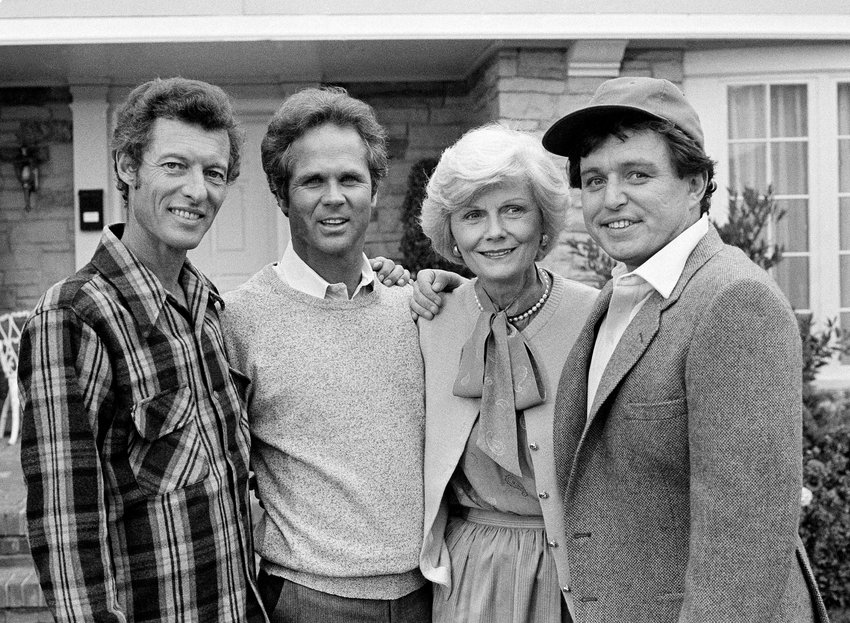 "FILE - This Dec. 10, 1982 file photo shows members of the original cast of the ""Leave It To Beaver,"" from left,  Ken Osmond, Tony Dow, Barbara Billingsley and Jerry Mathers during the filming of their TV special, ""Still The Beaver,"" in Los Angeles. Osmond, who played the two-faced teenage scoundrel Eddie Haskell on TV's ""Leave it to Beaver,"" has died. Osmond's family says he died Monday, May 18, 2020, in Los Angeles. He was 76. (AP Photo/Wally Fong, File)"