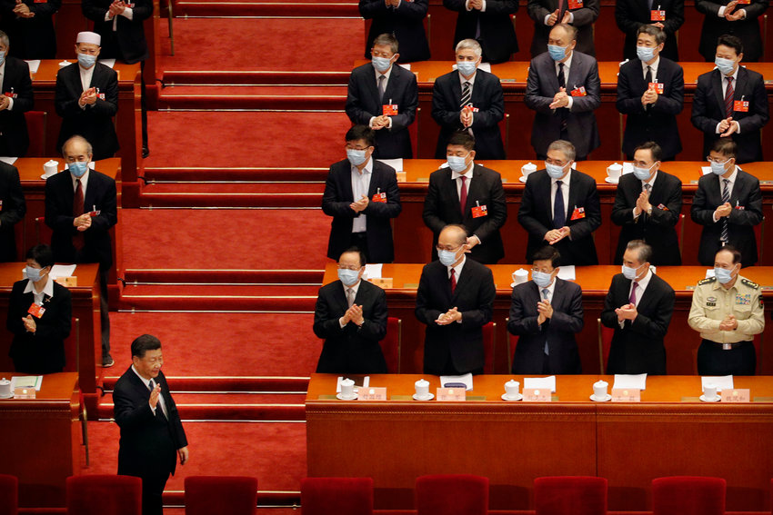 Chinese President Xi Jinping, left, gestures as he arrives for the opening session of the Chinese People's Political Consultative Conference (CPPCC) at the Great Hall of the People in Beijing, Thursday, May 21, 2020. (AP Photo/Andy Wong, Pool)