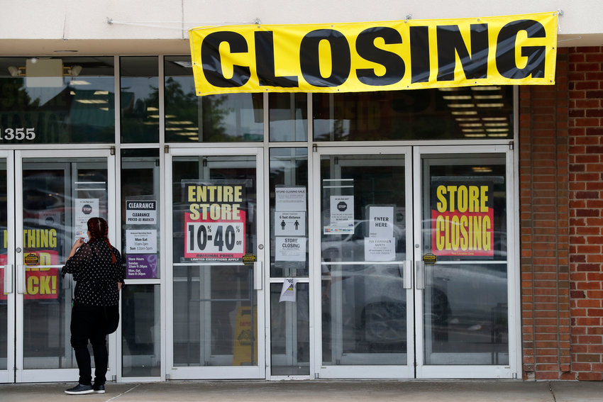 A woman walks into a closing Gordmans store Thursday, May 28, 2020, in St. Charles, Mo. Stage Stores, which owns Gordmans, is closing all its stores and has filed for Chapter 11 bankruptcy. (AP Photo/Jeff Roberson)