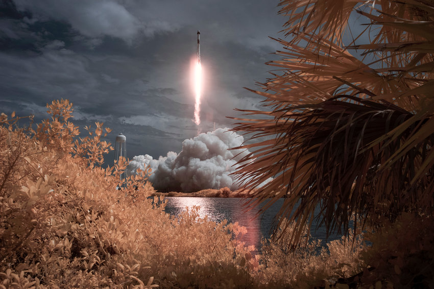 A SpaceX Falcon 9 rocket carrying the company's Crew Dragon spacecraft is seen in this false color infrared exposure as it is launched on NASA's SpaceX Demo-2 mission to the International Space Station with NASA astronauts Robert Behnken and Douglas Hurley onboard, Saturday, May 30, 2020, at NASA's Kennedy Space Center in Florida. The Demo-2 mission is the first launch with astronauts of the SpaceX Crew Dragon spacecraft and Falcon 9 rocket to the International Space Station as part of the agency's Commercial Crew Program. The test flight serves as an end-to-end demonstration of SpaceX's crew transportation system. Behnken and Hurley launched at 3:22 p.m. EDT on Saturday, May 30, from Launch Complex 39A at the Kennedy Space Center. A new era of human spaceflight is set to begin as American astronauts once again launch on an American rocket from American soil to low-Earth orbit for the first time since the conclusion of the Space Shuttle Program in 2011. Photo Credit: (NASA/Bill Ingalls)