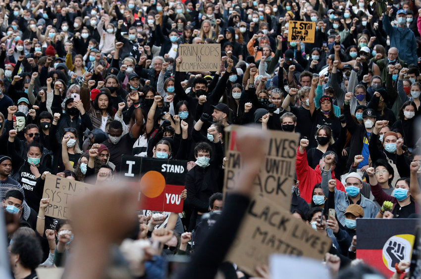 Thousands of protestors gather in Sydney, Saturday, June 6, 2020, to support the cause of U.S. protests over the death of George Floyd. Black Lives Matter protests across Australia proceeded mostly peacefully as thousands of demonstrators in state capitals honored the memory of George Floyd and protested the deaths of indigenous Australians in custody. (AP Photo/Rick Rycroft)..