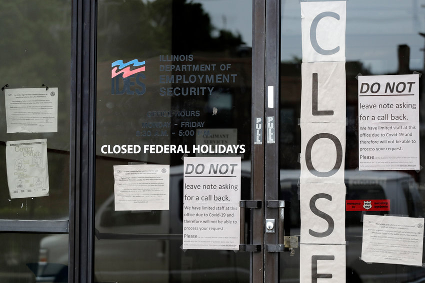 Information signs are posted at the Illinois Department of Employment Security Friday, June 5, 2020, in Chicago. The federal unemployment rate declined to 13.3 percent in May from 14.7 percent in April with a gain of 2.5 million jobs. (AP Photo/Nam Y. Huh)