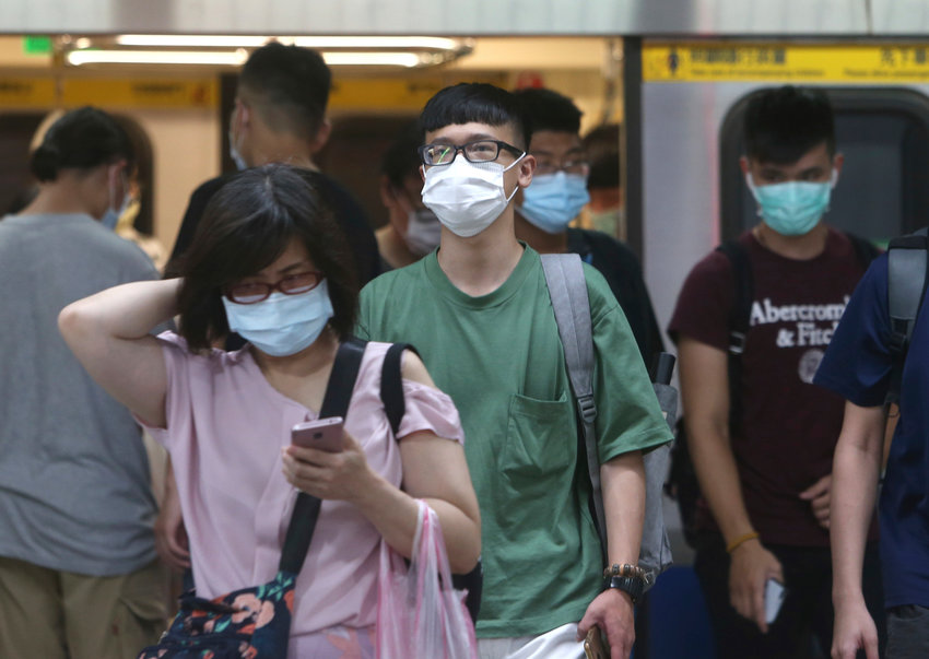 People wear face masks to protect against the spread of the coronavirus as they ride the subway in Taipei, Taiwan, Saturday, June 13, 2020. (AP Photo/Chiang Ying-ying)