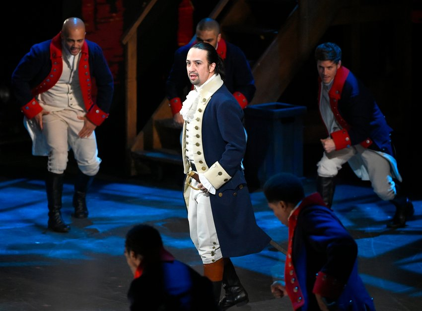 "In this June 12, 2016 file photo, Lin-Manuel Miranda and the cast of ""Hamilton"" perform at the Tony Awards in New York. A filmed version of the original Broadway production will be available Friday, July 3, on Disney Plus. (Photo by Evan Agostini/Invision/AP, File)"