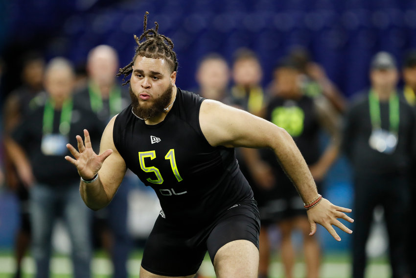 Alabama offensive lineman Jedrick Wills runs a drill at the NFL football scouting combine in Indianapolis, Friday, Feb. 28, 2020. (AP Photo/Charlie Neibergall)