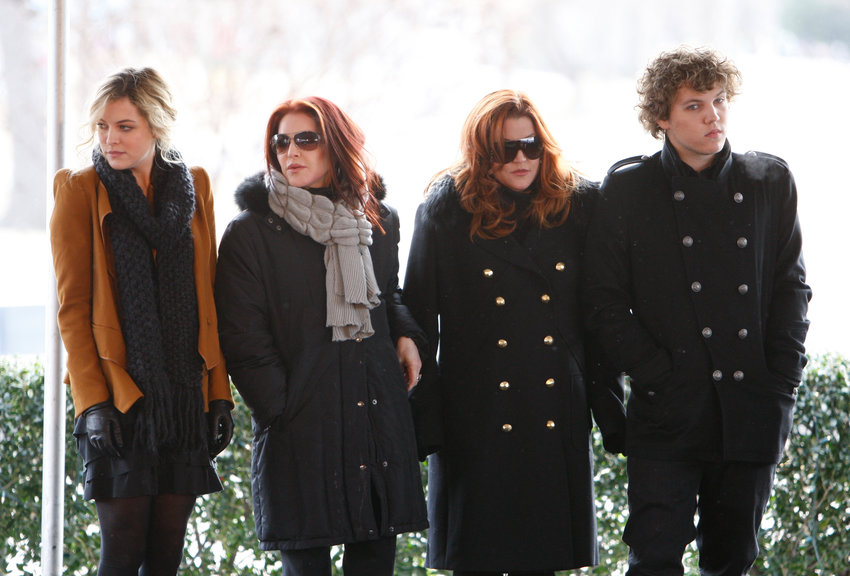 Priscilla Presley, second from left, her daughter, Lisa Marie, second from right, and Lisa Marie's children, Riley Keough, 21, left, and Benjamin Keough, 18, right, take part in a ceremony commemorating Elvis Presley's 75th birthday on Friday, Jan. 8, 2010 in Memphis, Tenn. (AP Photo/Mark Humphrey)
