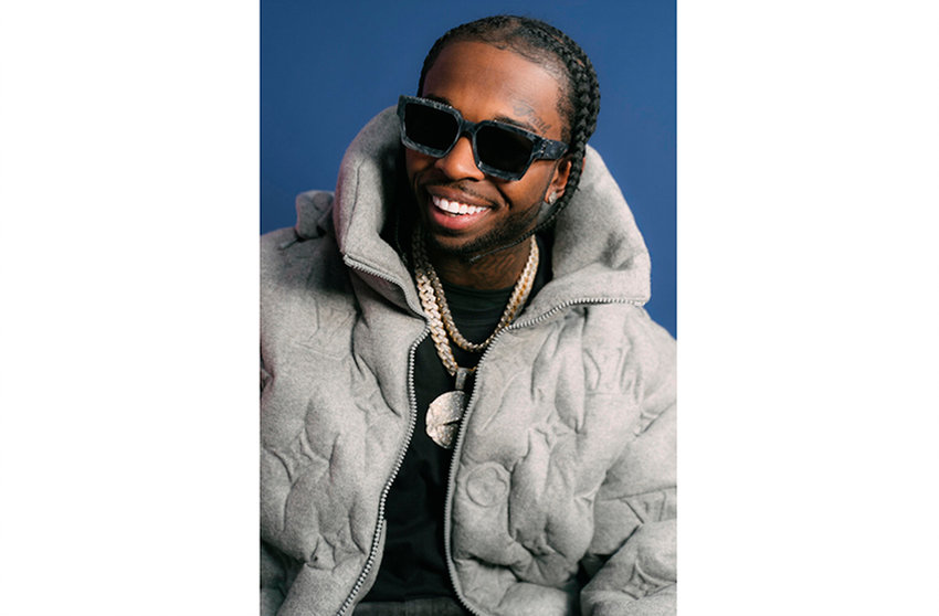 This image released by Republic Records shows rapper Pop Smoke. Authorities believe the rising rapper, whose legal name is Bashar Barakah Jackson, was shot and killed during a Los Angeles home-invasion robbery in February after his social media posts led five suspects to the house he was renting. Prosecutors say two men and two teens have been charged in the death of the rapper. Los Angeles District Attorney Jackie Lacey said in a statement Monday, July 13, 2020, that Corey Walker and Keandre Rodgers were charged with a murder that occurred during the commission of a robbery and burglary. The two male teens were also charged with murder and robbery in juvenile court. (Tracy Awino/Republic Records via AP)