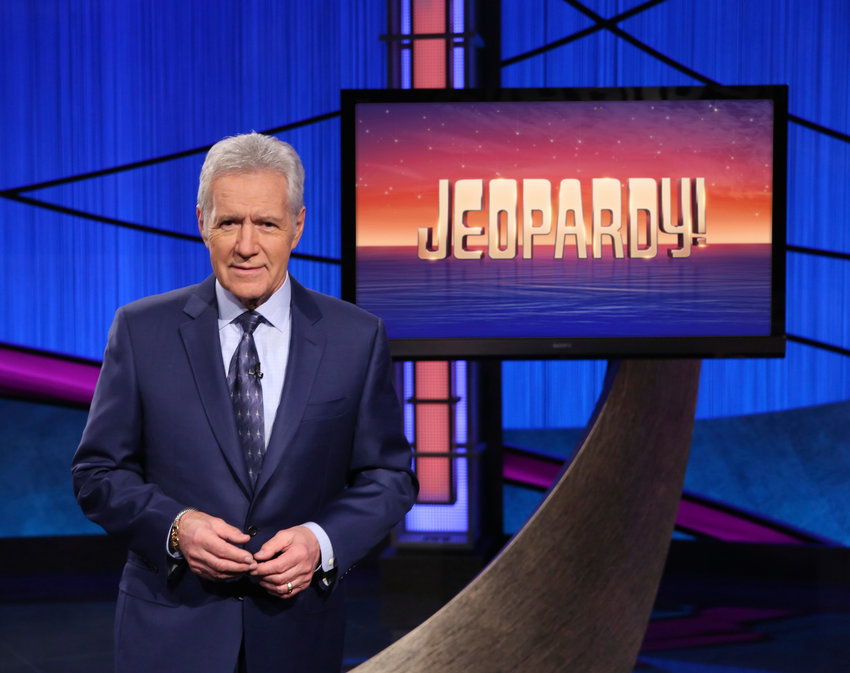 """This image released by Jeopardy! shows Alex Trebek, host of the game show """"Jeopardy!"""" Trebek's memoir, """"The Answer Is…: Reflections on My Life,"""" will be released on Tuesday, July 21. (Jeopardy! via AP)"""