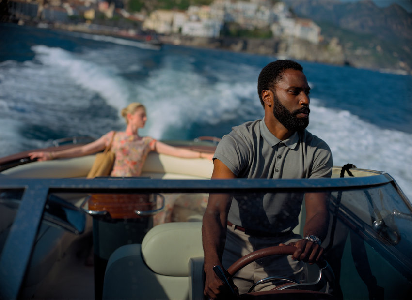 """This image released by Warner Bros. Entertainment shows Elizabeth Debicki, left, and John David Washington in a scene from """"Tenet.""""  The film, which had hoped to herald Hollywood's return to big theatrical releases, has yet again postponed its release due to the ongoing coronavirus pandemic. Warner Bros. said Monday that """"Tenet"""" will not make its August 12 release date. And unlike previous delays, the studio this time didn't announce a new target for the release of Nolan's much-anticipated $200 million thriller.  (Melinda Sue Gordon/Warner Bros. Entertainment via AP)"""