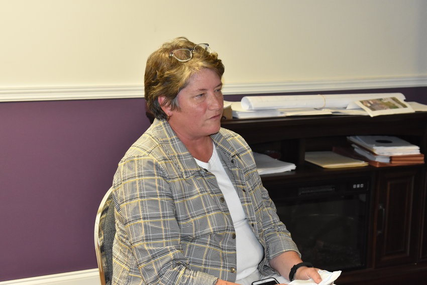 Donna Kilgore of the Jasper Area Family Service Center temporarily takes off her mask and maintains social distance while discussing the center's Head Start and adult education plans for the old Parrish High School Thursday with the Parrish Town Council.
