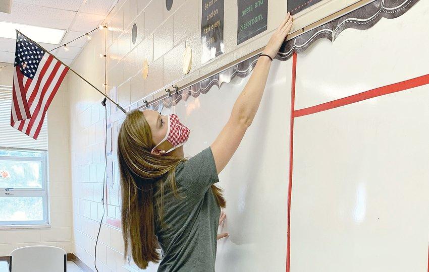 Dora High School English teacher Miranda Barnes decorates her classroom in preparation for the start of the school year.