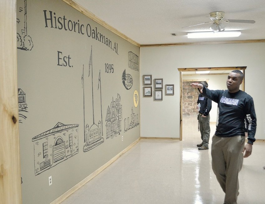 Cory Franks will remain mayor of Oakman. Here Franks giving a tour of the Oakman Senior Center that was remodeled during his first term.