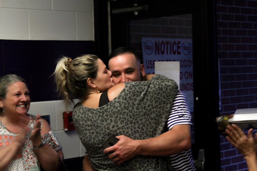 Bubba Cagle and fiance Kayse Brown celebrate Tuesday night following his win in Tuesday's Parrish mayoral race.
